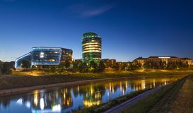 Beautiful night panorama right bank of river in Vilnius city. Beautiful modern and old buildings drops nice colorful illumination on river in night Lithuania Royalty Free Stock Photos