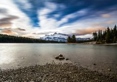 Beautiful night scene from shoreline of lake with mountain on fa royalty free stock photo