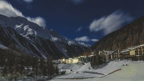 Beautiful night scenery of popular ski resort Solda Sulden. Candid vintage photography Royalty Free Stock Image
