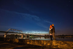 Beautiful night scenery, the stars in the night sky, a couple on a background of the night sky Royalty Free Stock Photography
