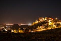 Beautiful Night Shot of Illuminated Spanish Village on a Hill wi Stock Image
