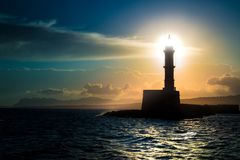 A beautiful night sky behind a shining lighthouse. Chania, Crete, Greece stock photo