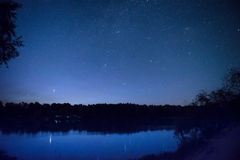 Beautiful night sky with many stars on a lake royalty free stock photos