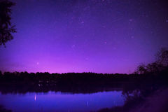 Beautiful night sky with many stars on a lake Royalty Free Stock Photography