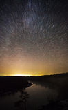 Beautiful night sky, the Milky Way, star tracks and the trees Royalty Free Stock Images
