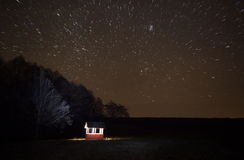 A beautiful night sky, Milky Way, star tracks and the trees Stock Image