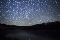 Beautiful night sky, the Milky Way, star trails and the trees Stock Photos