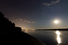 Beautiful night sky with moon and constellation over Danube river Royalty Free Stock Photos
