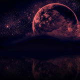 Beautiful Night sky with silhouette mountains and close planet Stock Photo