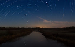 Beautiful night sky, spiral star trails and the forest Royalty Free Stock Image