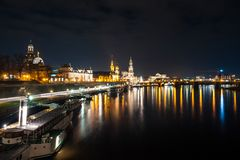 Beautiful night view of the city and reflections in the Elbe riv. Er in Dresden, Germany Royalty Free Stock Photos