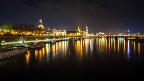 Beautiful night view of the city and reflections in the Elbe riv. Er in Dresden, Germany Royalty Free Stock Images
