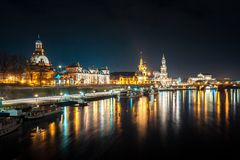 Beautiful night view of the city and reflections in the Elbe riv. Er in Dresden, Germany Royalty Free Stock Image