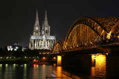 Beautiful night view of the Cologne Cathedral. Cologne, Germany - October 16, 2013. Beautiful night view of the Cologne Cathedral and the bridge over the river Stock Photography