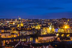 Beautiful Night view over the Vltava river, Charles bridge, the embankment Smetanovo, tower old city, Church St. Assisi. Magnificent Night view over the Vltava Royalty Free Stock Image