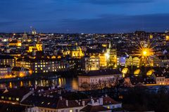 Beautiful Night view over the Vltava river, Charles bridge, the embankment Smetanovo, tower old city, Church St. Assisi. Magnificent Night view over the Vltava Stock Photo