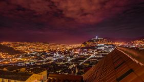 Beautiful night view of Quito mixing new architecture with charming streets, with a panecillo turist place in the. Mountain in front, in the city of Quito Royalty Free Stock Photo