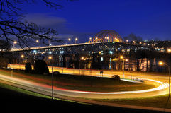 Beautiful Night View of the Road Leading to the bridge Stock Photos
