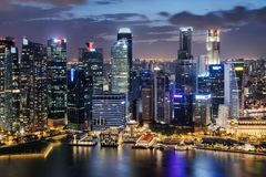 Beautiful night view of skyscrapers at downtown of Singapore. Colorful city lights reflected in water of Marina Bay. Amazing cityscape. Singapore is a popular royalty free stock image