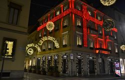Beautiful night view to the decorated for the Christmas in red stripes Cartier fashion boutique. stock photography