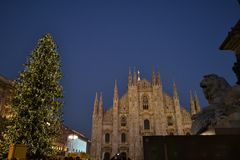 Beautiful night view to the Duomo square of Milan decorated with the Christmas tree. stock photography
