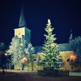 Beautiful night winter photo Christmas tree with church and snow. Royalty Free Stock Image