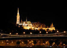 Beautiful nightly landscape of Budapest. BUDAPEST - HUNGARY - OCTOBER 2013: View on the Matthias Church and and the Fisherman`s Bastion by night Stock Photos