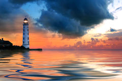 Beautiful nightly seascape with lighthouse royalty free stock photo