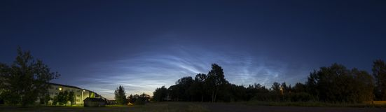 Beautiful Noctilucent Clouds Panorama. Noctilucent clouds are mysterious and visible in deep twilight. They are the highest clouds in Earth's atmosphere, located Royalty Free Stock Images