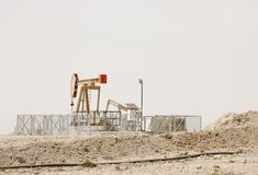 A beautiful nodding Donkey oil pumps in Bahrain oil field Stock Photo