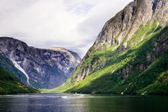 Beautiful nordic landscape with spectacular norwegian fjord - long, narrow inlet with steep sides or cliffs, created by a glacier. Image with copy space stock photos