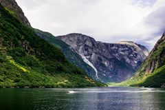 Beautiful nordic landscape with spectacular norwegian fjord - long, narrow inlet with steep sides or cliffs, created by a glacier. Image with copy space Stock Photography