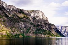 Beautiful nordic landscape with spectacular norwegian fjord - long, narrow inlet with steep sides or cliffs, created by a glacier. Image with copy space stock image