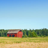 Beautiful nordic red house against the blue sky Stock Photo