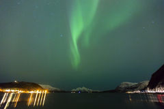 Beautiful northern lights over a fjord at night Stock Photography