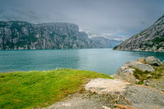 Beautiful Norwegian fjord panorama by the coast of Lysefjord, Norway Royalty Free Stock Photos