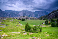 Beautiful Norwegian fjord panorama by the coast of Lysefjord, Norway Royalty Free Stock Images