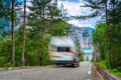 Beautiful Norwegian fjord panorama by the coast of Lysefjord, Norway - RV passing by on the road Stock Photography