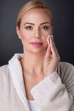 Beautiful nourished woman cleaning her face Stock Photos