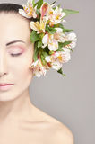 Beautiful Nude attractive brunette with flowers on his head. Fashion beautiful makeup, clean skin, facial care. Portrait of young. Beautiful woman with perfect Stock Images