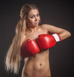 Beautiful nude girl with boxing gloves Stock Photography