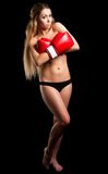 Beautiful nude girl with boxing gloves Royalty Free Stock Photo