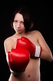 Beautiful nude girl with boxing gloves Stock Photos