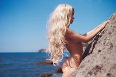 Beautiful nude woman on beach Stock Photo