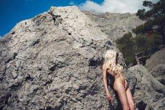 Beautiful nude woman on beach Stock Photos