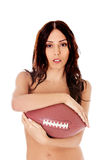 Beautiful nude woman holding american football ball. Stock Photos