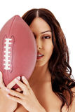 Beautiful nude woman holding american football ball. Beautiful woman nude holding an american football  over white background Royalty Free Stock Photos