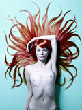 Beautiful nude woman with magnificent hair Royalty Free Stock Images
