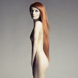 Beautiful nude woman with magnificent hair Royalty Free Stock Photos