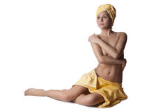 Beautiful nude woman with a towel. On his head sitting on a white background. Girl after shower Stock Photo